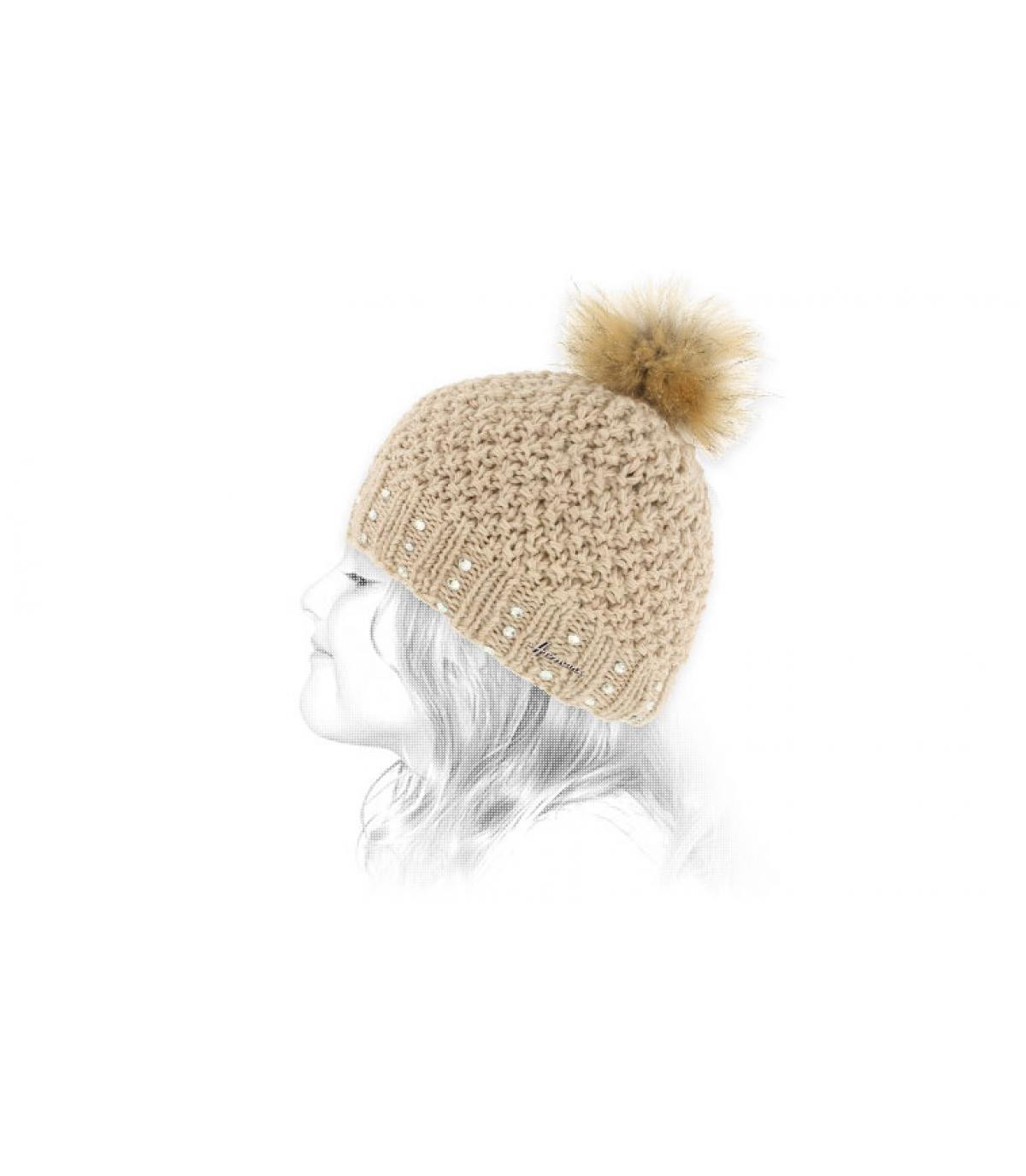 amarillento de la piel del niño sombrero de pompón